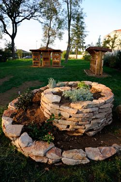 Spiral rock bed perfect for hiding a small tree stump