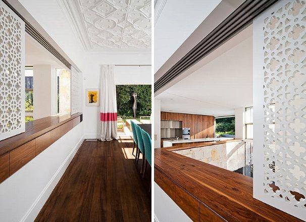 ntre a cozinha e a sala de jantar o balcão tem janela com acabamento vazado formando um lindo painel vazado.