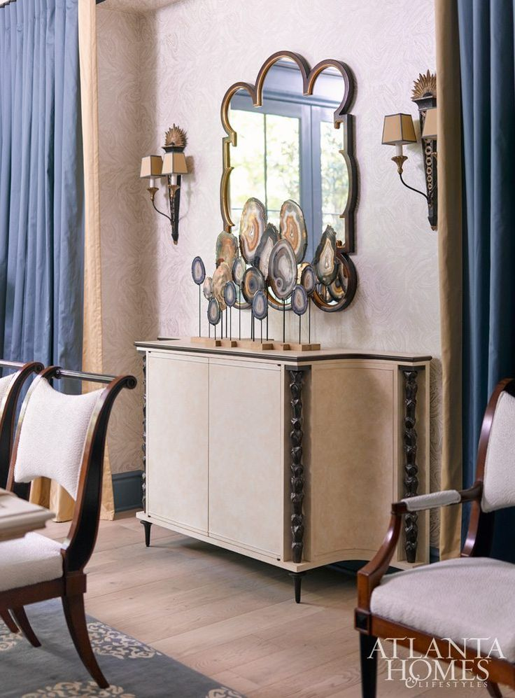 In Jonathan Savage's dining room, a Maison Jansen-designed dining table anchors the space, while warm creams mixed with soft golds, muted blues, and fine textures foster an intimate feel. Paul Ferrante pendants through Ainsworth-Noah. Antique sconces, Parc Monceau.