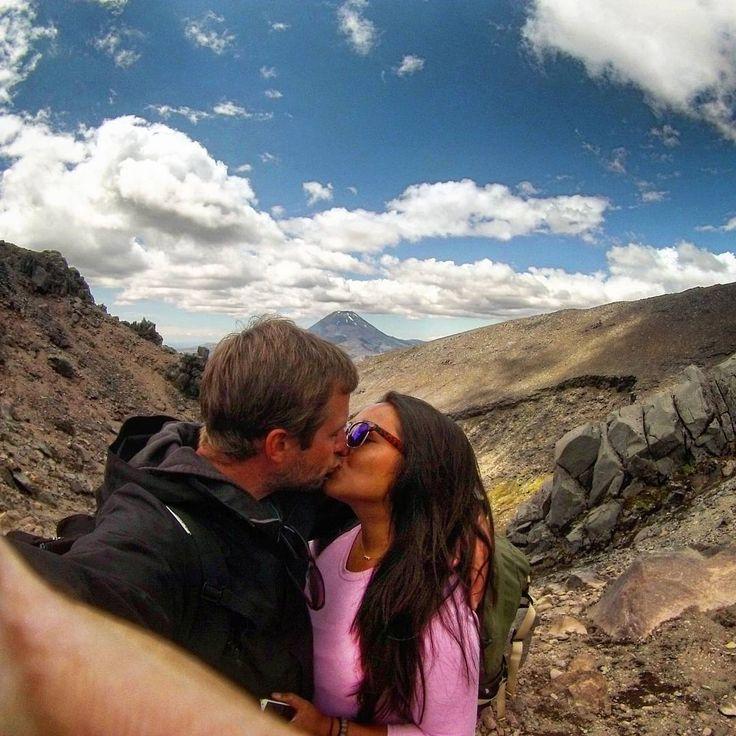 Mid hike kiss with Mt. Ngauruhoe photobombing in the background #kissesallovertheworld #happybirthday #adventures #loveyou #nzmustdo #newzealand #travel #clouds #theadventuresofjoandjake #hiking @newzealandvacations @outdooradventurephotos @natgeotravel