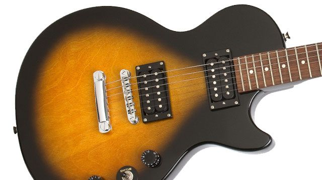 My husband has this one - Epiphone Les Paul Special II in Vintage Sunburst. Great beginner guitar.
