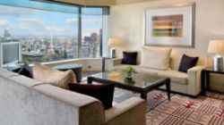 The living area in the 5 star residential style Diplomatic Suite at the Grand Hyatt Melbourne