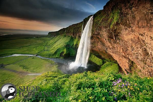 Seljalandsfoss / The lush green hills of near the unique Seljalandsfoss waterfall. This signed photo print is mounted on a 3mm thick white high quality mount which fits a standard frame size. Size: 30x40 cm (photo size:20x30 cm) - Nordic Store Iceland