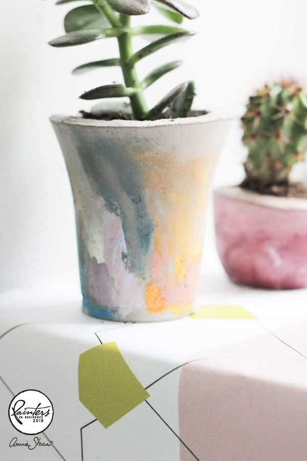 Annie Sloan Painter in Residece Hester van Overbeek made these mini concrete pots and planted them with cacti and succulents. She painted them with random strokes of Chalk Paint® pastel colours. Click the link to make them yourself!