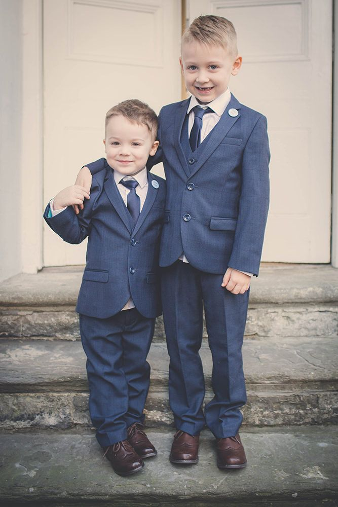 Page boys in three piece navy suits with brown shoes  - Image by Rocksalt Photography - Esme by Jenny Packham For A Traditional Wedding In Wales With A Navy And Silver Colour Scheme And Bridesmaids In Navy Dresses From BHS With Images From Rocksalt Photography