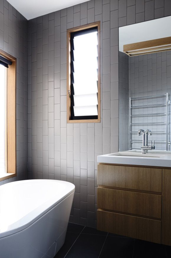 Like the interesting use of grey subway tiles and timber in this bathroom by Rob Kennon Architects   Stepped House