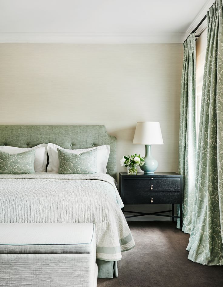 Touches of green in the upholstered bedhead, European cushions and drapes create a timeless and classic feel to this bedroom in a renovated 1930s Georgian home. Photography: Lisa Cohen