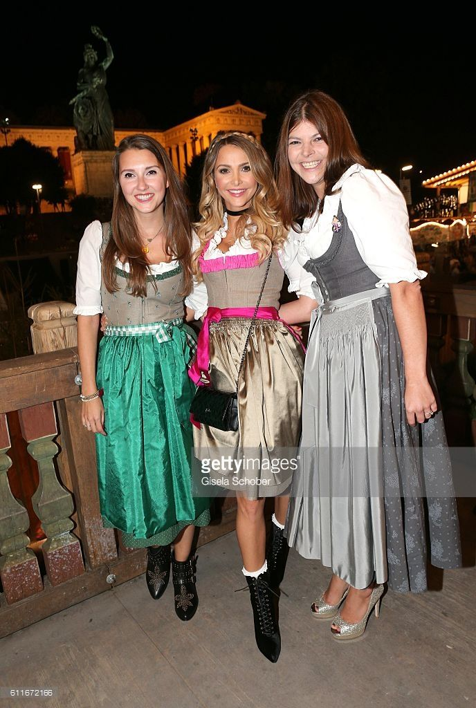 Charlotte Hermann and her sister Sophie Hermann and stepsister Julia Tewaag, Julia Frank, daughter of Uschi Glas during the Oktoberfest at Theresienwiese on September 30, 2016 in Munich, Germany.