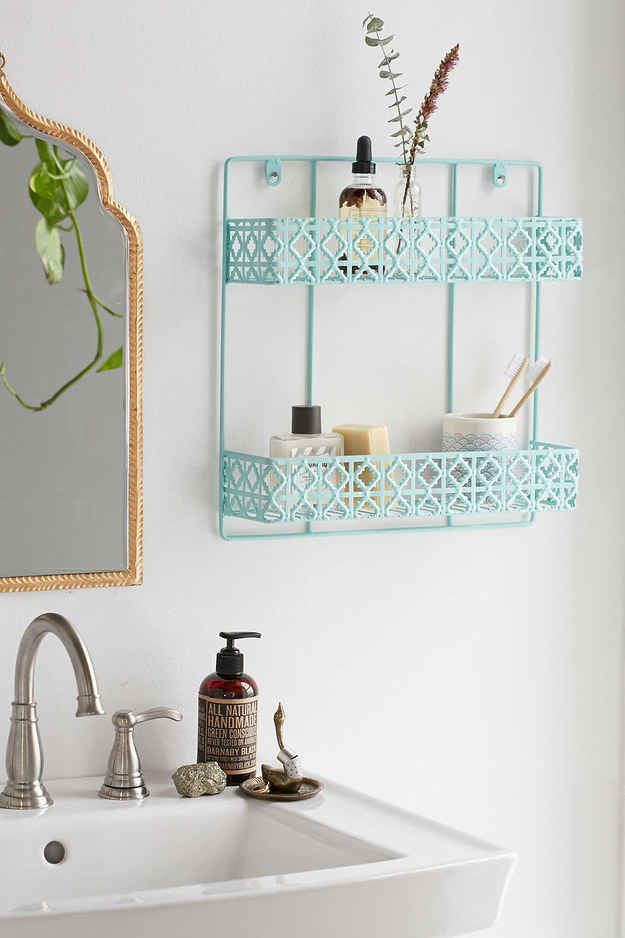 Or if you wanna get fancy with it, use one of these shelving units to hold your bathroom products.