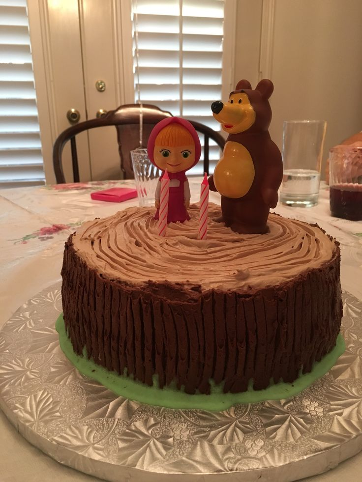 Simple Masha and the Bear Cake Ideas - chocolate buttercream log cake with Masha and the Bear bath toys as cake toppers