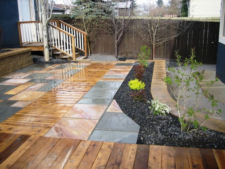 Cedar decking insert with natural stone patio...    Visit us: www.steelheadconstruction.com/about-us/  Source: www.morgank.ca/photo-gallery/landscaping-hardscaping-photos/cedar-decking-inset-with-natural-stone-patio/