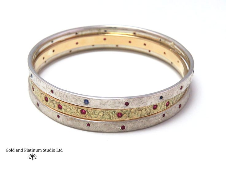 Silver and gold ruby and sapphire set stacking bangles. Look beautiful in a mixture of metals, or even on their own!