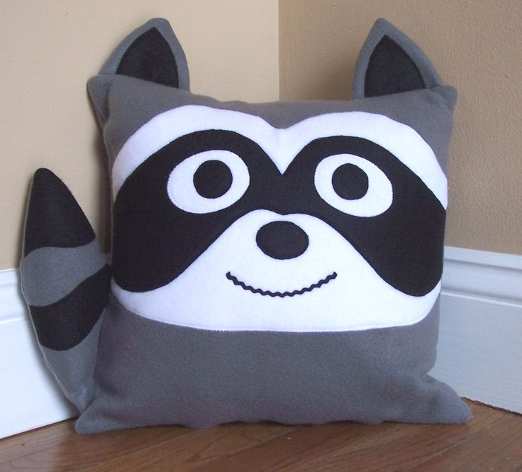 Raccoon Animal Pillow from 3 Silly Monkeys on Etsy.  14 x14 pillow made from soft fleece.  $20.00