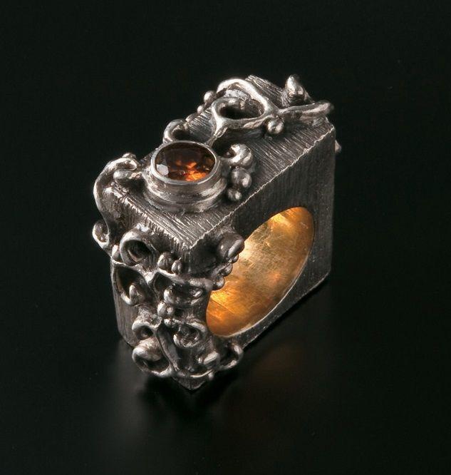 Art Clay Silver (fine silver) gent's ring. Paste over core, scroll-work, gilt shank, bezel-set titanite sphene. Artist: Alan Samons – South Africa. 2011