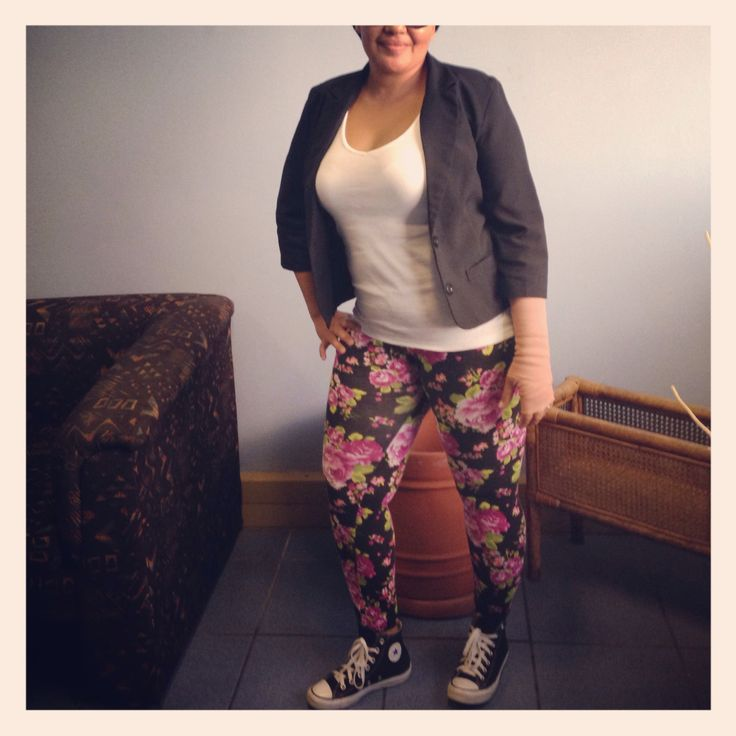 DO pair a black jacket with a white tank top, floral leggings and Converse Chuck Taylors for a funky office look <3