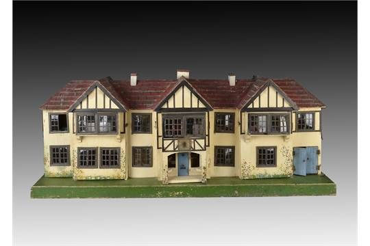 A Tri-ang Stockbroker type dolls' house DH/64 1932, cream painted with painted timbers, red paint