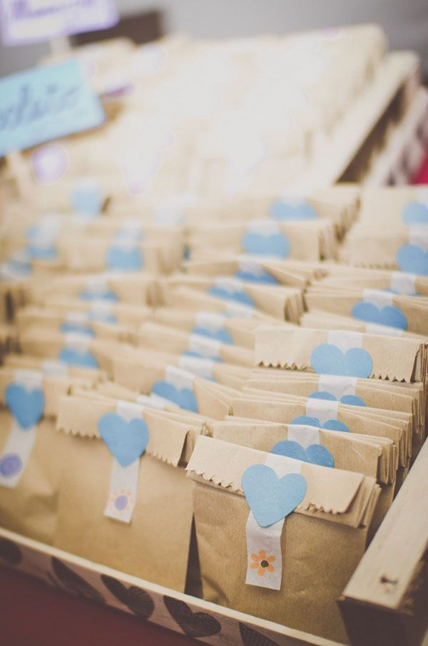 favors in kraft bags - love the blue heart stickers! photo by Infraordinario