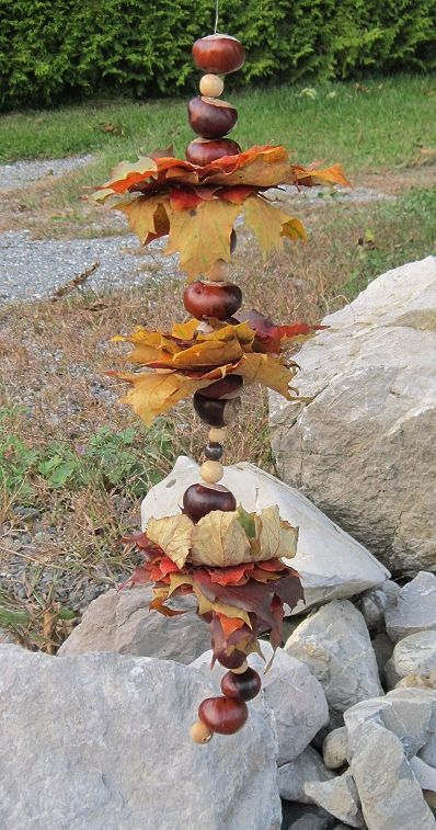 Acorns, nuts and leaves on a string