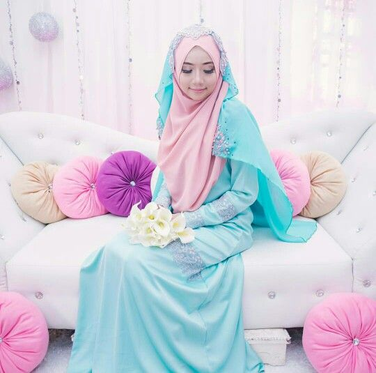 Pretty in pink hijab and beautiful in blue bridal outfit...photo by…