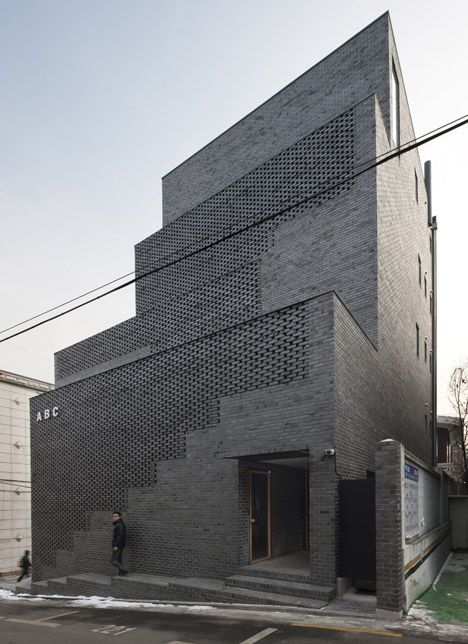 Perforated brick stairwells front Wise Architecture's ABC office block.