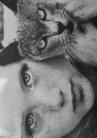Guess I believe in freckles and cats...and black and white photography. Beautiful!