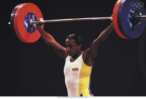 María Urrutia Ocoró the first gold medalist in women's 75kg weightlifting, 2000. The only Colombian gold medalist (so far), María went on to serve in the Chamber of Representatives of Colombia (Lower House of Congress) from 2002 to 2010. Update: During the 2012 Games, Colombian Mariana Pajon won the country's second gold in women's BMX.