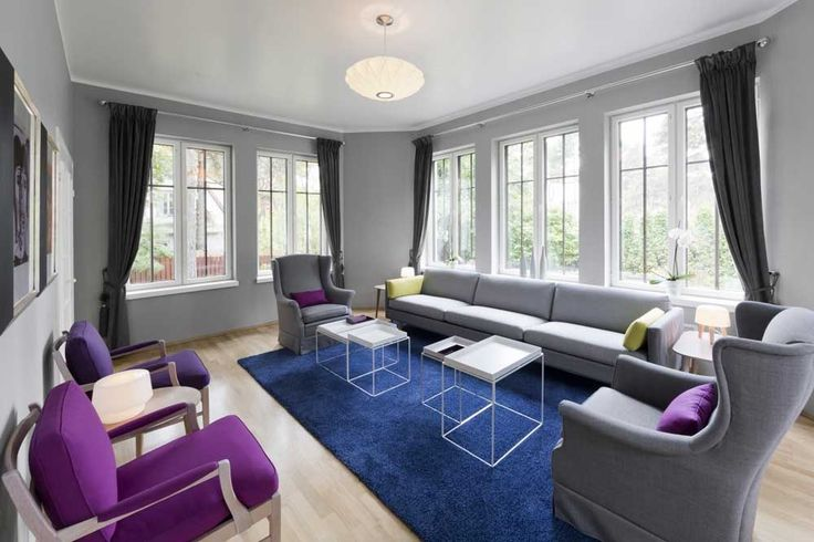 Grey Sofa Living Room Design Ideas dark gray couch and blue carpet also purple chairs