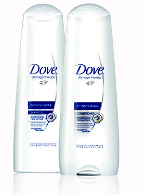Dove Intensive Repair Shampoo and Conditioner.  Inexpensive and works wonders!