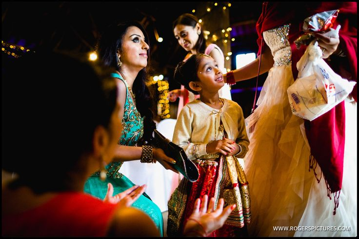 Wedding guests arrive at the Great Barn in Ruislip before Matt and Sundeep's wedding -
