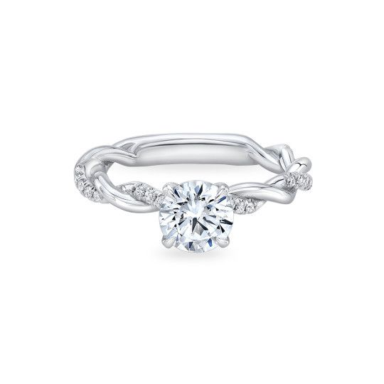 A whisper thin tendril of high polish precious metal interwines with a sparkling diamond vine, culminating in a low set center setting that blossoms into four petal shaped pointed prongs to secure a center diamond. Nests perfectly with an eventual accompanying wedding band. #engagementrings
