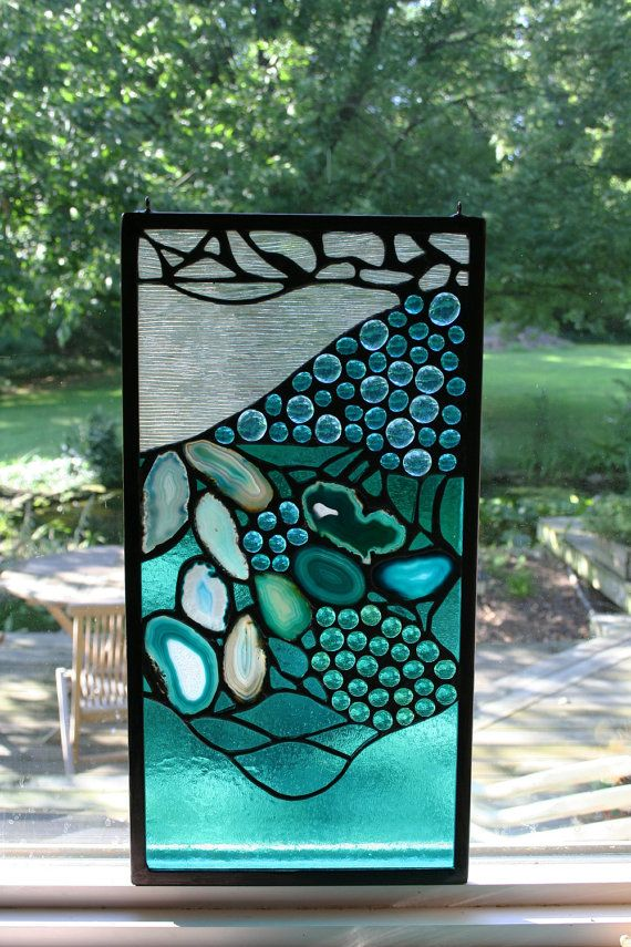 Stained glass window panel with agates