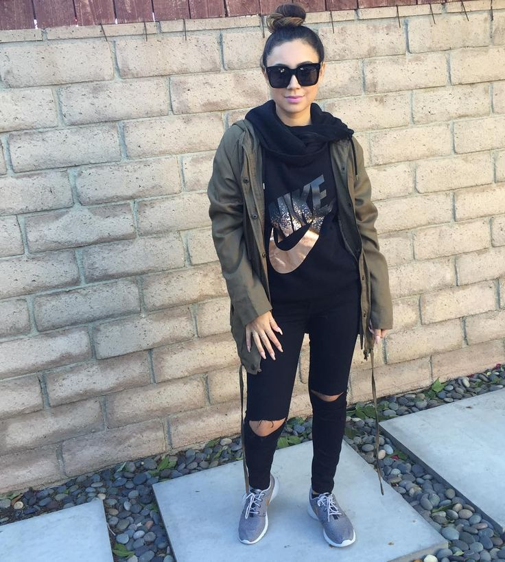 Comfortable Outfit. Hair in a bun, Black Nike Sweater, Green Army Jacket, Black denim, & Nike tennis shoes. By styledbyale.