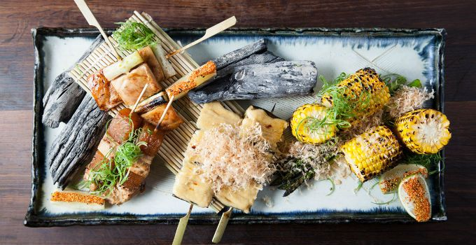 Just because you can't afford to travel around the world doesn't mean your tastebuds can't at these 10 Brisbane restaurants.