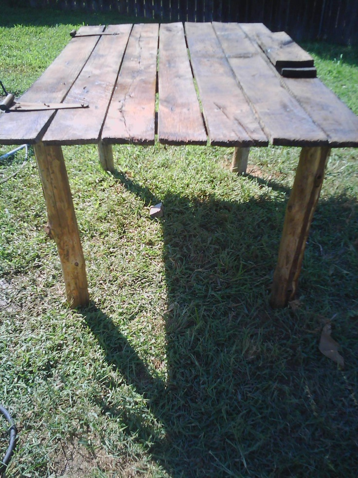 Nathan made a barn wood table for our new back yard...eeeppp!