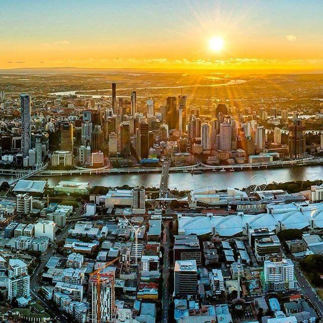 Brisbane City aglow in the rays of the rising sun ☀ : @will_brown_115 from Aerial Advantage #brisbaneanyday