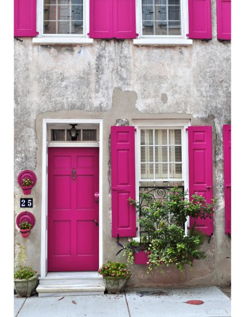 Bright Pink Front Door With White Trim. They Have Also Used This Same  Colour Pink On The Window Shutters And Window Boxes To Balance The Colour  Through Out ...