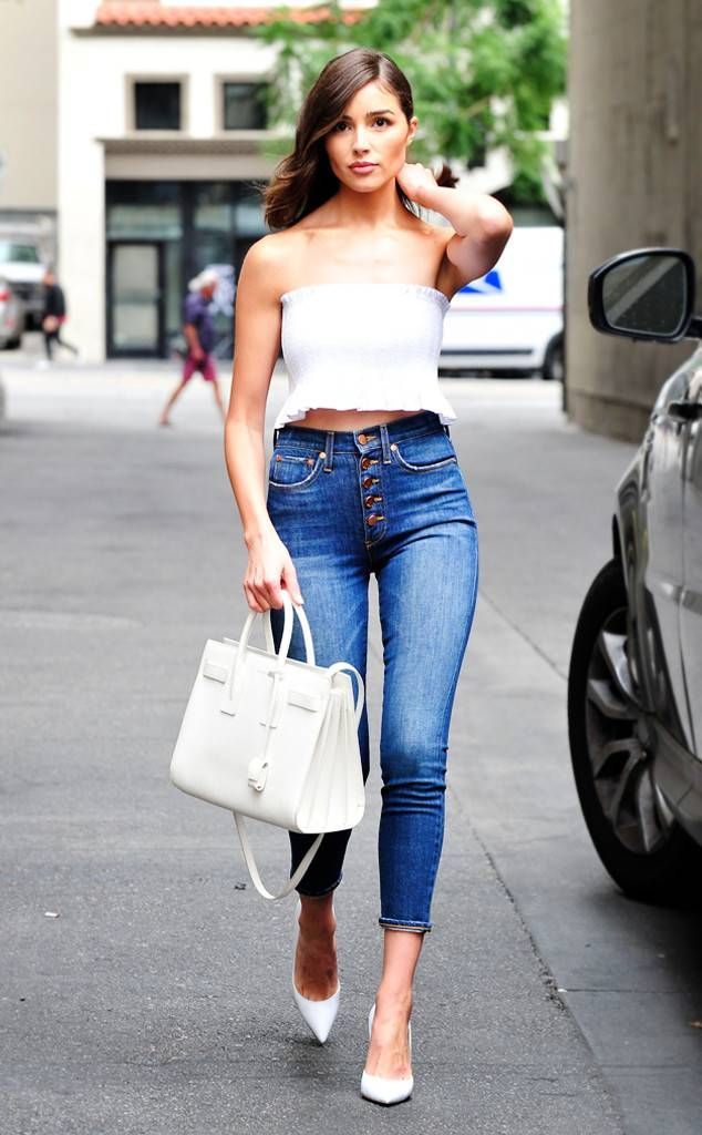 be83b284be0 Olivia Culpo s Street Style - casual wear White tube top with high waisted  button-fly denim jeans.