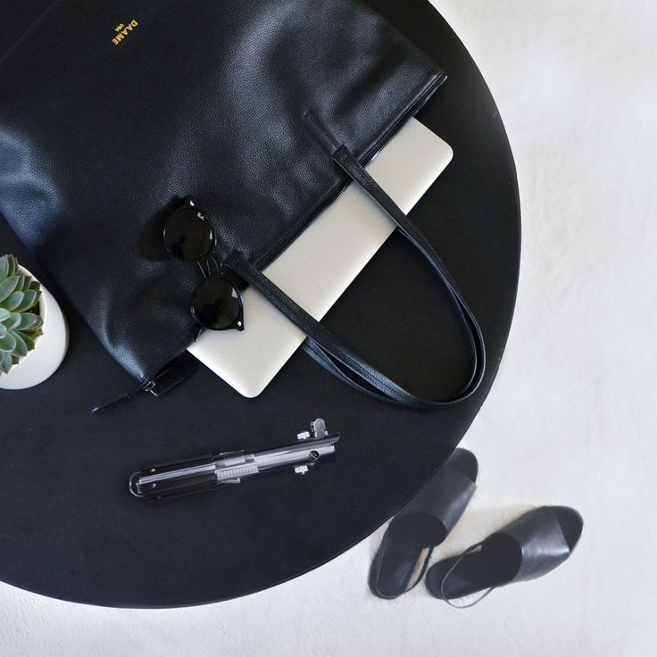 A stylish laptop bag with a zip top and a padded laptop sleeve. It is a laptop tote you can take everywhere from the board room and beyond. 13-laptop tote, Dana in black. #Maythe4thbewithyou #laptoptote #stylishlaptopbag