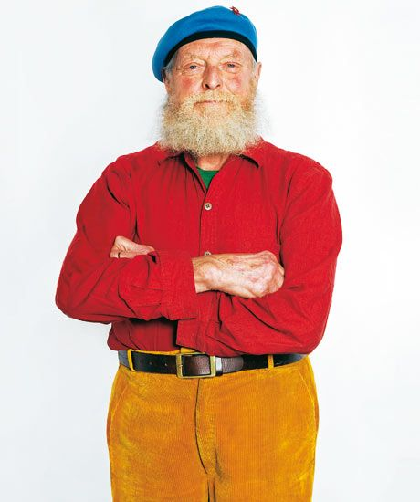 """""""I like wearing bright colours. My trousers are from Gallyons countrywear shop in Norwich, and my beret is from the UN peacekeeping force. Being a toymaker is quite a romantic notion. I play with cars and trains and boats and planes all day – it's a substitute for real life. I don't want to look drab. I live in a world of make-believe."""" said Ron Fuller, the toymaker"""