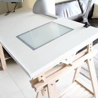 The IKEAhacked adjustable angle drawing table. I like the idea of having a light table handy, as well as the way in which you can adjust the table with the pegs.
