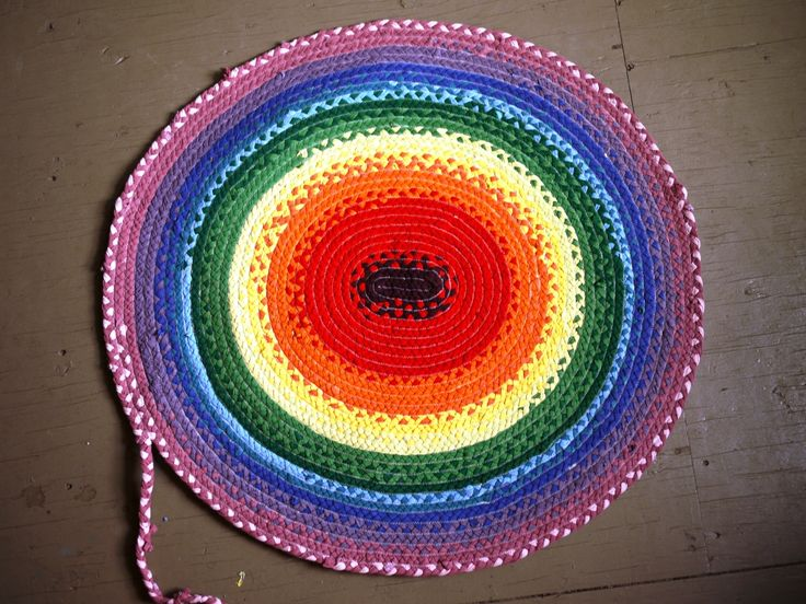 Colorful braided rag rug from tshirts.  Cut into strips, braid them, and then sew into shape.  Brilliant tutorial.  I want to make a HUGE one!