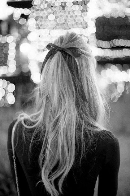Put a bow on it: Pulling the hair off of the face and into a half-up hairstyle is elegant and timeless. Kick it up by adding a girly bow around the elastic.