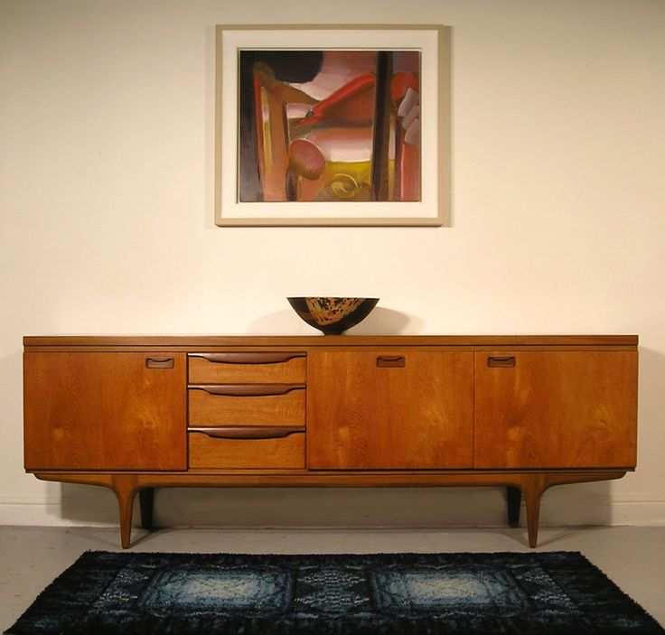 "Greaves and Thomas sideboard.  	  GREAVES & THOMAS TEAK SIDEBOARD 1967220cm x 46cm deep x 80cm high 7ft 3"" x 18"" deep x 30"" high  SOLD  - A striking sideboard by quality English maker Greaves and Thomas - Attractive asymmetrical design with sculptural solid afromosia handles - Superb condition throughout. - Refinished, oiled and waxed. - Very attractive teak grain pattern on all surfaces."