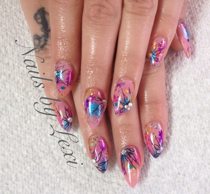 Stiletto nails with Artistic Colour gloss in Fantasy. Nail art created using CND pigments, confetti glitter, and hand painted flowers