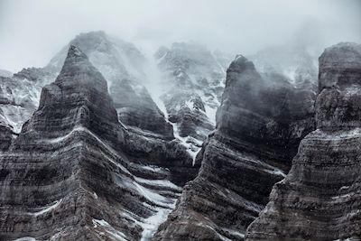 Martin Olson - Erosion Rocks. Snowy mountain tops.