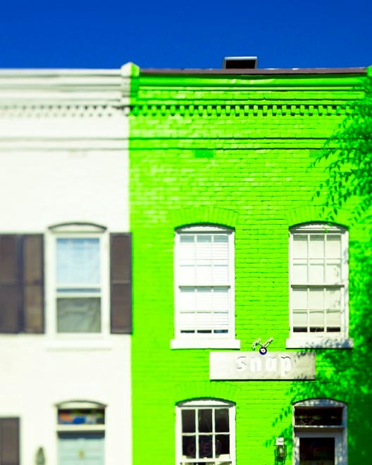 We love a bold statement like this neon green house!