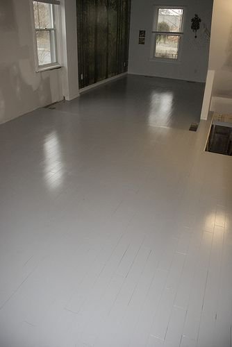 painted wood floors - benjamin moore floor paint pigeon grey. Home depot. Started as lots of floor board remnants (all same width) but a multitude of colours to keep the cost down,