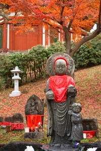 In Japan, the color red is associated closely with a few deities in Shinto and Buddhist traditions, so statues of these deities are often decked in red clothing or painted red.
