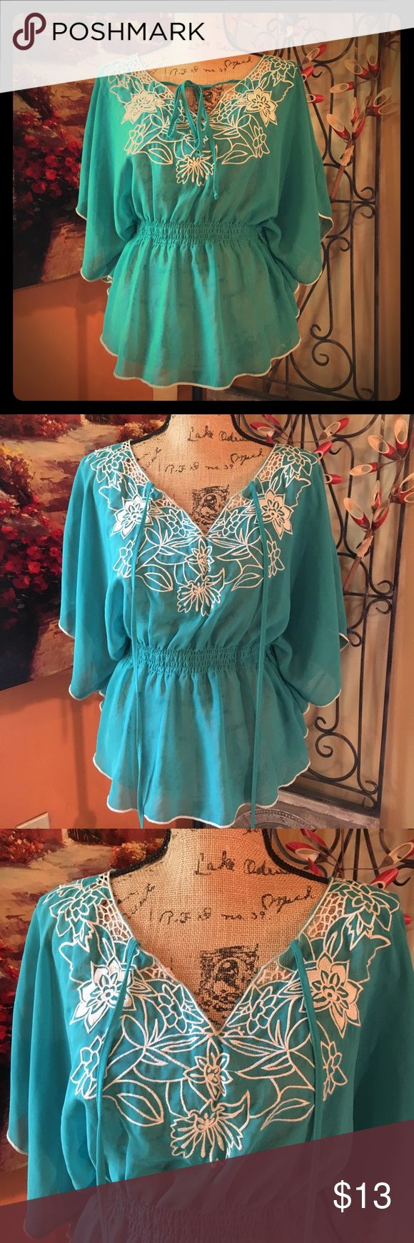 "Rhapsody Tunic Sheer Turquoise polyester Tunic with cream floral stitched design & sleeve / bottom trim, long collar ties, cinched waist band & batwing sleeves with side drape. Sz XL in great condition, 38""-40"" bust with lots of extra room with loose drape, 23"" length rhapsody Tops Tunics"