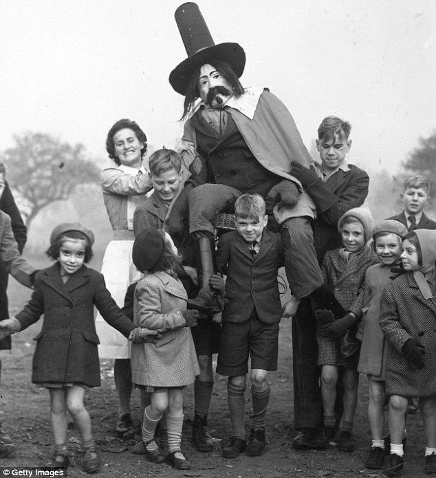 'Go on, mister, g'is a penny for the guy!' A nurse joins in the Guy Fawkes fun at a children's home in Wanstead, Essex, 1947.